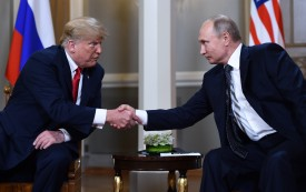 Russian President Vladimir Putin and U.S. President Donald Trump shake hands before a meeting in Helsinki, Finland, on July 16. (Brendan Smialowski/ AFP/Getty Images)