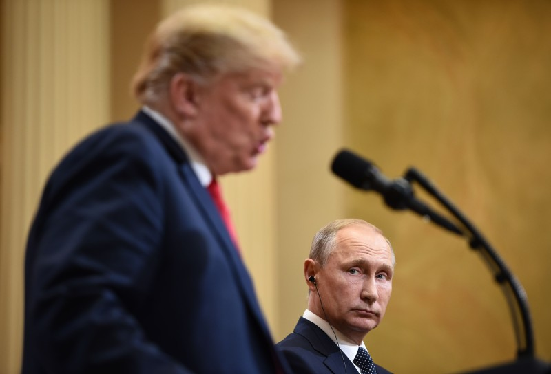 US President Donald Trump and Russia's President Vladimir Putin attend a joint press conference after a meeting at the Presidential Palace in Helsinki, on July 16, 2018. (BRENDAN SMIALOWSKI/AFP/Getty Images)