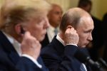 U.S. President Donald Trump and Russian President Vladimir Putin give a joint press conference after a meeting at the Presidential Palace in Helsinki on July 16. (Brendan Smialowski/ AFP/Getty Images)