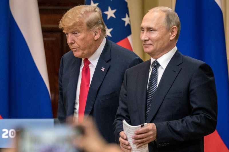 U.S. President Donald Trump and Russian President Vladimir Putin speak during a joint press conference after their summit on in Helsinki on July 16. (Chris McGrath/Getty Images)