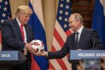 Russian President Vladimir Putin hands President Donald Trump a World Cup football during a joint press conference after their summit on July 16, 2018 in Helsinki, Finland. (Chris McGrath/Getty Images)
