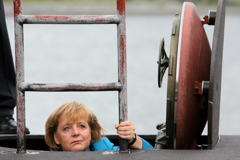 German Chancellor Angela Merkel stepping out of a 212 A submarine of the German Marine in Rostock Warnemuende, northeastern Germany. (JENS BUETTNER/AFP/Getty Images)