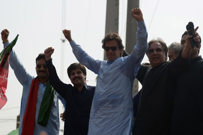 Pakistani opposition leader Imran Khan (C) gestures from the stage during a by-election campaign event in Karachi on April 9, 2015. (RIZWAN TABASSUM/AFP/Getty Images)