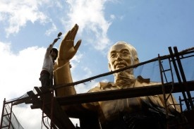 This picture taken on January 24, 2016 shows a worker repainting a large statue of the late president Ho Chi Minh, founder of today's communist Vietnam, at a public park in the southern city of Can (STR/AFP/Getty Images)