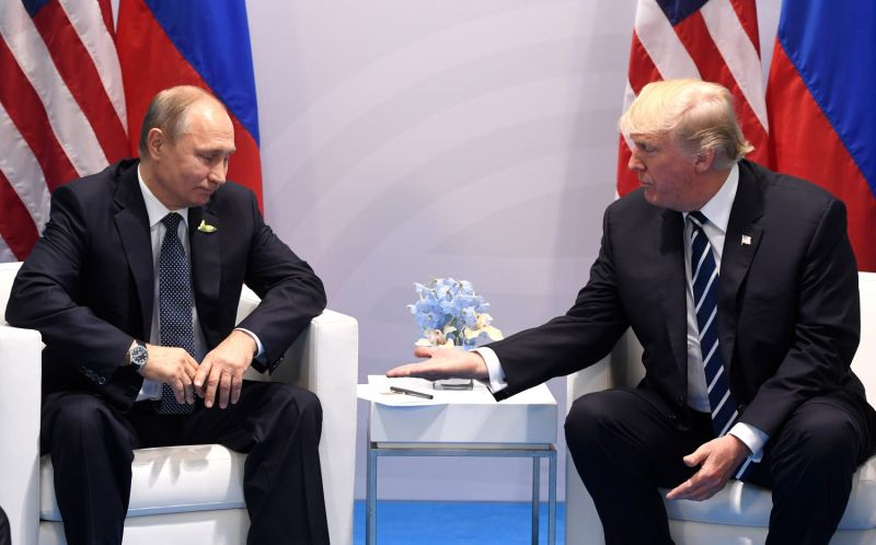 U.S. President Donald Trump and Russian President Vladimir Putin shake hands during a meeting on the sidelines of the G-20 Summit in Hamburg, Germany, on July 7, 2017. (Saul Loeb/AFP/Getty Images)