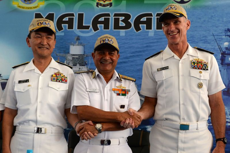 Japanese Rear Admiral Hiroshi Yamamura (L), US Rear Admiral William Byrne (R) and HCS Bisht, vice admiral of the Indian Navy, pose for photographers during the inauguration of joint naval exercises with the United States and India in Chennai on July 10, 2017. (ARUN SANKAR/AFP/Getty Images)