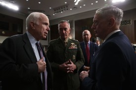 U.S. Secretary of Defense Jim Mattis (R) and Chairman of the Joint Chiefs of Staff General Joseph Dunford (2nd L) listen to committee chairman Sen. John McCain (R-AZ) prior to a hearing before Senate Armed Services Committee October 3, 2017 on Capitol Hill in Washington, DC. (Alex Wong/Getty Images)