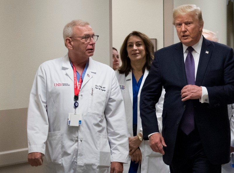 Dr. John Fildes walks with President Donald Trump at University Medical Center, October 4, 2017 in Las Vegas, Nevada. (Drew Angerer/Getty Images)