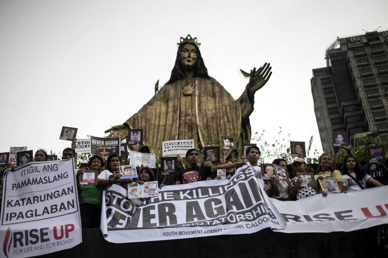 Relatives of people killed during the anti-drug operation participate in a Catholic-led  protest in Manila on November 5, 2017. (NOEL CELIS/AFP/Getty Images)