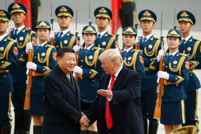 U.S. President Donald Trump takes part in a welcoming ceremony with Chinese President Xi Jinping in Beijing on Nov. 9, 2017. (Thomas Peter-Pool/Getty Images)