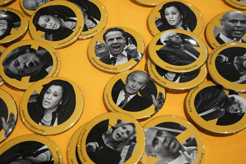 Buttons of possible 2020 presidential contenders, including U.S. Sen. Bernie Sanders (I-VT), Sen. Elizabeth Warren (D-MA), Sen. Cory Booker (D-NJ), Sen. Kirsten Gillibrand (D-NY), Sen. Kamala Harris (D-CA), New York State Gov. Chris Cuomo and former Vice President Joseph Biden, are seen during CPAC 2018 February 22, 2018 in National Harbor, Maryland. (Alex Wong/Getty Images)