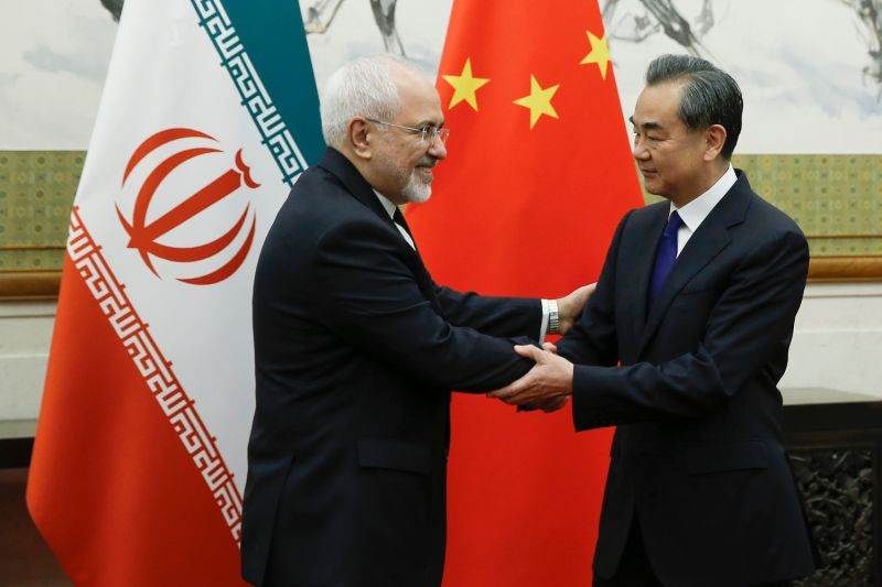Chinese State Councillor and Foreign Minister Wang Yi (R) meets Iran's Foreign Minister Mohammad Javad Zarif at the Diaoyutai state guesthouse in Beijing on May 13, 2018. (THOMAS PETER/AFP/Getty Images)