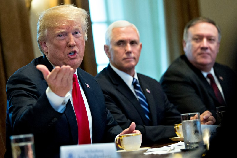 U.S. President Donald Trump speaks alongside Vice President Mike Pence, and Secretary of State Mike Pompeo during a meeting with NATO Secretary General Jens Stoltenberg, at the White House on May 17. (Andrew Harrer-Pool/Getty Images)