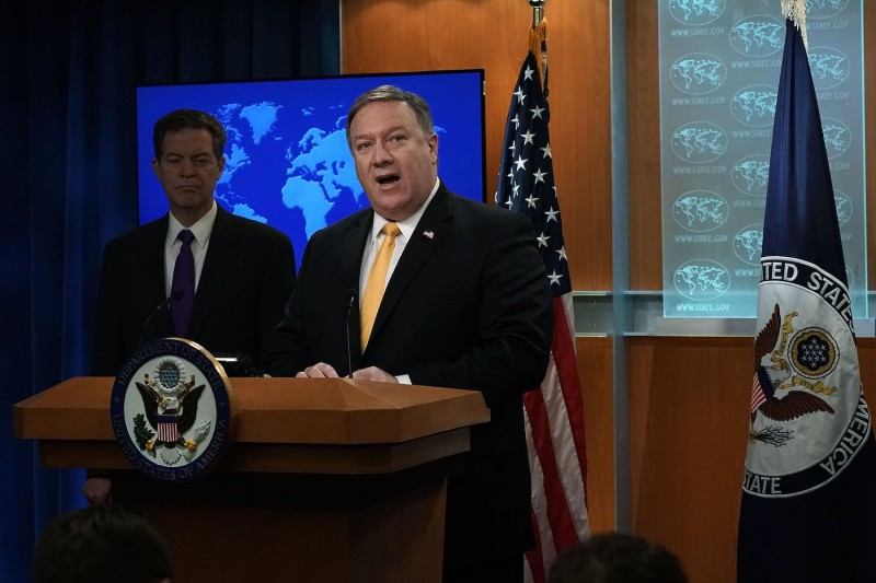 U.S. Secretary of State Mike Pompeo, right, and Sam Brownback, the U.S. ambassador at large for international religious freedom, at a press event for the launch of the department's 2017 Annual Report on International Religious Freedom on May 29 in Washington. (Alex Wong/Getty Images)