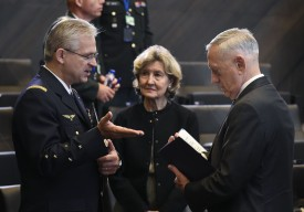 U.S. Ambassador to NATO Kay Bailey Hutchison talks with U.S. Defense Secretary James Mattis (right) and Gen. Denis Mercier, NATO's supreme commander for transformation, during a meeting at NATO headquarters in Brussels on June 8. (John Thys/AFP/Getty Images)