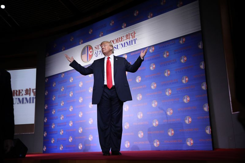 Donald Trump answers a final question while departing a press conference following his historic meeting with North Korean leader Kim Jong-un June 12, 2018 in Singapore. (Win McNamee/Getty Images)