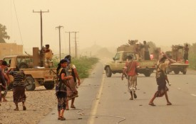 Pro-government forces gather south of the Hodeida airport in Yemen on June 15. (AFP/Getty Images)