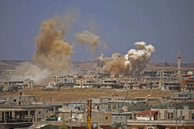 Smoke rises above opposition held areas of the city of Daraa during airstrikes by Syrian regime forces on June 29, 2018.     (MOHAMAD ABAZEED/AFP/Getty Images)