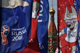Flags with the logo and the World Cup 2018 mascot Zabivaka are seen in front of Saint Basil's Cathedral in Moscow on June 30, 2018 during the Russia 2018 World Cup football tournament. (Photo by Vasily MAXIMOV / AFP)        (Photo credit should read VASILY MAXIMOV/AFP/Getty Images)