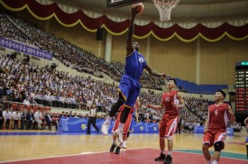 This photo taken on July 5, 2018 shows players from North (red) and South Korea (blue) competing during a friendly men's basketball match at the Ryugyong Chung Ju-Yung Indoor Stadium in Pyongyang. (KIM WON-JIN/AFP/Getty Images)