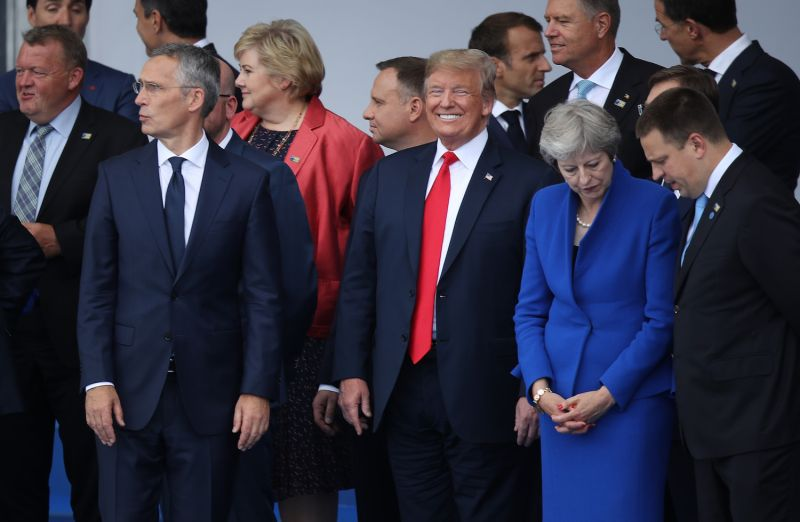 NATO Secretary-General Jens Stoltenberg, U.S. President Donald Trump, and British Prime Minister Theresa May at a NATO summit in Brussels on July 11. (Sean Gallup/Getty Images)