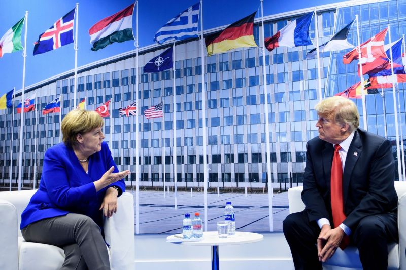German Chancellor Angela Merkel and U.S. President Donald Trump speak to the press after a bilateral meeting on the sidelines of the NATO summit in Brussels on July 11. (Brendan Smialowski/AFP/Getty Images)