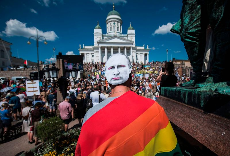 A demonstrator wears a mask bearing a portrait of Russian President Vladimir Putin as protesters gather for a march to defend human rights, freedom of speech, and democracy on July 15, ahead of U.S. President Donald Trump's meeting with Putin in Helsinki. (Jonathan Nackstrand/AFP)