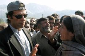 Pakistani cricketer-turned politician Imran Khan comforts a Kashmiri woman during a visit to Muzaffarabad, the capital of Pakistani-administered Kashmir in November 2005.
