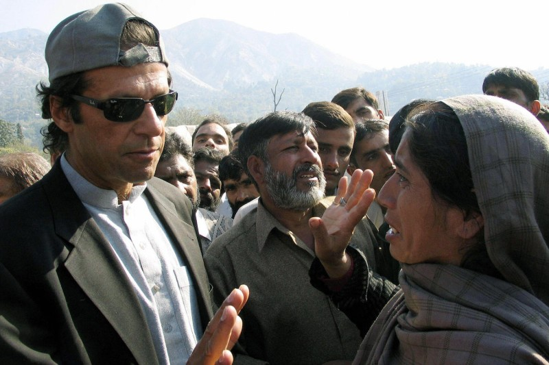 Pakistani cricketer-turned politician Imran Khan comforts a Kashmiri woman during a visit to Muzaffarabad, the capital of Pakistani-administered Kashmir in November 2005.