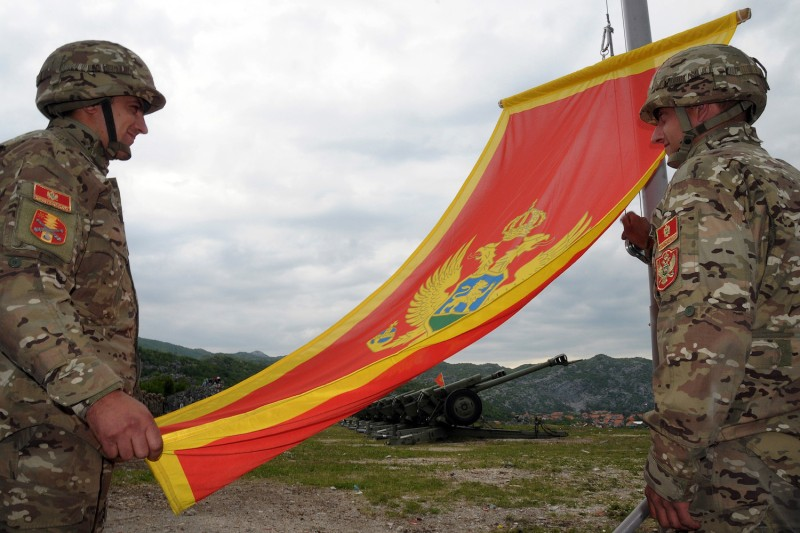 Montenegrin Army soldiers fire artillery look at the Montenegro flag during preparations on the eve of Independence day, on May 20, 2010 in Cetinje, Montenegro.