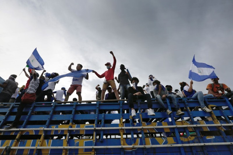 Anti-government demonstrators hold a protest demanding Nicaraguan President Daniel Ortega and his wife, Vice President Rosario Murillo, to stand down, in Managua on May 26, 2018.