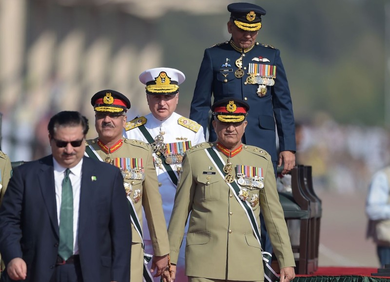 Pakistani Army Chief General Qamar Javed Bajwa (second from the right), Pakistani Chief of Naval Staff Admiral Zafar Mahmood Abbasi (center), Pakistani Air Chief Marshal Mujahid Anwar Khan (top-right) and Pakistani Chairman of the Joint Chiefs of Staff Committee Zubair Mahmood Hayat (second from left) arrive to receive Sri Lankan President Maithripala Sirisena during the Pakistan Day military parade in Islamabad on March 23. (Aamir Qureshi/AFP/Getty Images)