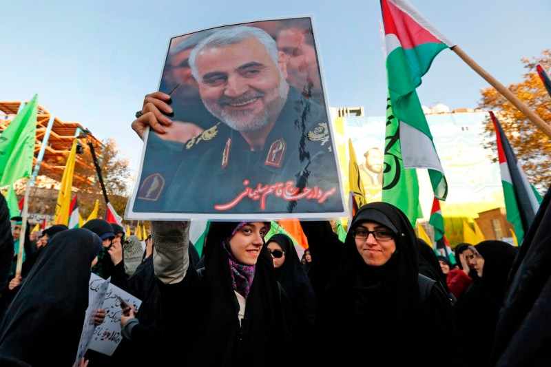 Iranian protesters hold a portrait of the commander of the Iranian Revolutionary Guard's Quds Force, Gen. Qassem Suleimani, during a demonstration in the capital Tehran on December 11, 2017.