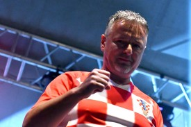 Croatian nationalist singer Marko Perkovic (known as Thompson) performs during an event to welcome Zlatko Dalic, Croatia's national football coach, at a local stadium in the Western-Bosnian town of Livno on July 24, 2018.