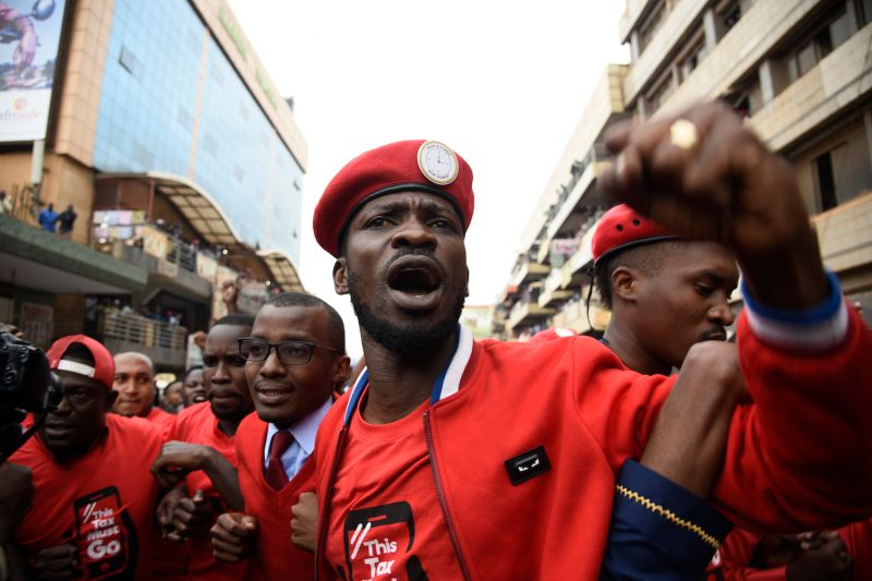 Musician turned politician Robert Kyagulanyi (C) is joined by other activists on July 11, 2018 in Kampala, Uganda during a protest against a controversial tax on the use of social media.