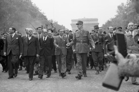 Gen. Charles de Gaulle leads a triumphant procession down Champs-Élysées as part of the celebration of the liberation of Paris. To the right of de Gaulle is Gen. Jacques-Philippe Leclerc, commander of the French Armored Division. (Bettmann Archive/Getty Images)