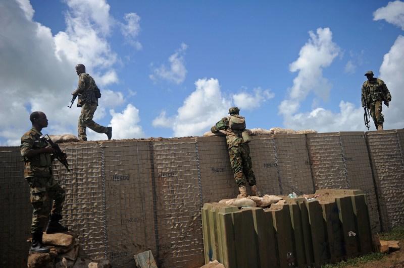 Somali soldiers patrol Sanguuni military base south of Mogadishu, Somalia, on June 13. (Mohamed Abdiwahab/AFP/Getty Images)