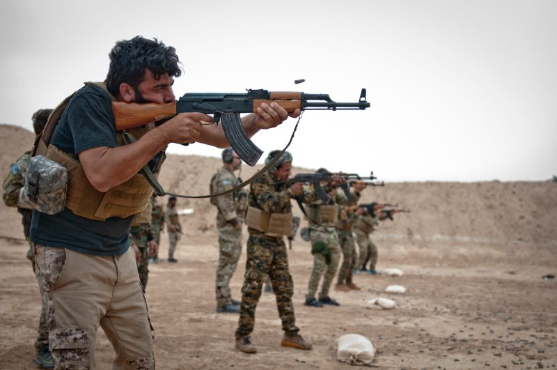 A firing line of Syrian Democratic Forces soldiers take aim and fire at targets during a marksmanship training exercise to prepare for Operation Roundup, an SDF-led campaign to clear the last Islamic State strongholds, near Shaddadi, Syria, on May 27. (Staff Sgt. Timothy R. Koster/U.S. Army)