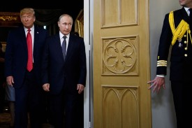 U.S. President Donald Trump and Russian President Vladimir Putin arrive for their meeting in Helsinki on July 16. (Brendan Smialowski / AFP/Getty Images)