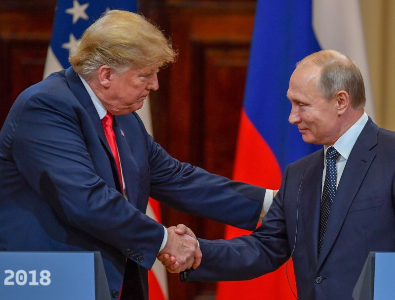 U.S. President Donald Trump, left, and Russian President Vladimir Putin shake hands before attending a joint press conference after a meeting at the Presidential Palace in Helsinki on July 16, 2018. (Yuri Kadobnov/AFP/Getty Images)