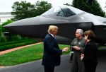 U.S. President Donald Trump speaks with Alan B. Norman, director and chief test pilot, and Marillyn A. Hewson, the chairman, president, and chief executive officer of Lockheed Martin, next to an F-35 at the White House on July 23. (Photo by Brendan Smialowski / AFP)