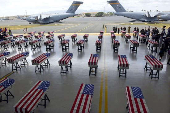 Flag draped transfer cases with the remains of American soldiers repatriated from North Korea are seen during a ceremony after arriving to Joint Base Pearl Harbor-Hickam, Honolulu, Hawaii, on August 1, 2018. RONEN ZILBERMAN/AFP/Getty Images