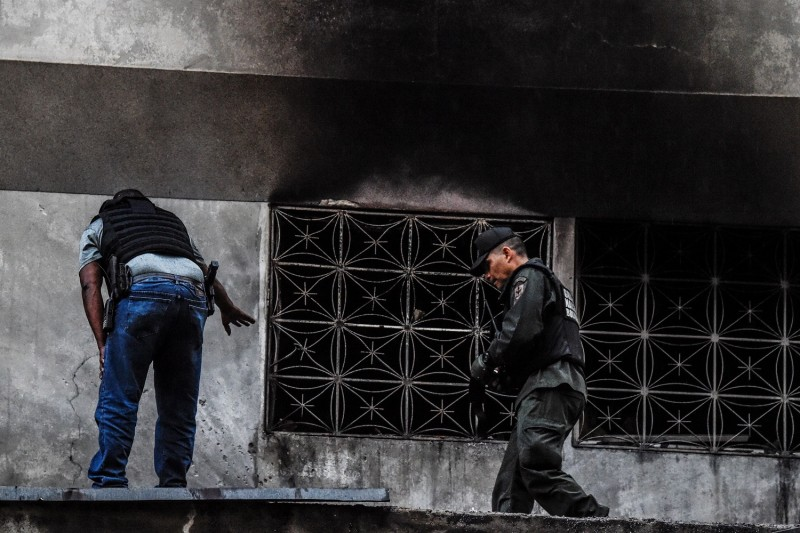 Venezuelan security forces check a nearby building after a drone attack on President Nicolás Maduro  in Caracas on Aug. 4. (Juan Barreto/AFP/Getty Images)