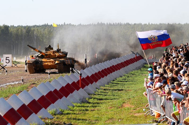 Belarus' crew on a T-72B3 battle tank competes in a final relay race of the tank biathlon competition at the International Army Games in Alabino, Moscow region, on Aug. 11. (Anton NovoderezhkinTASS via Getty Images)