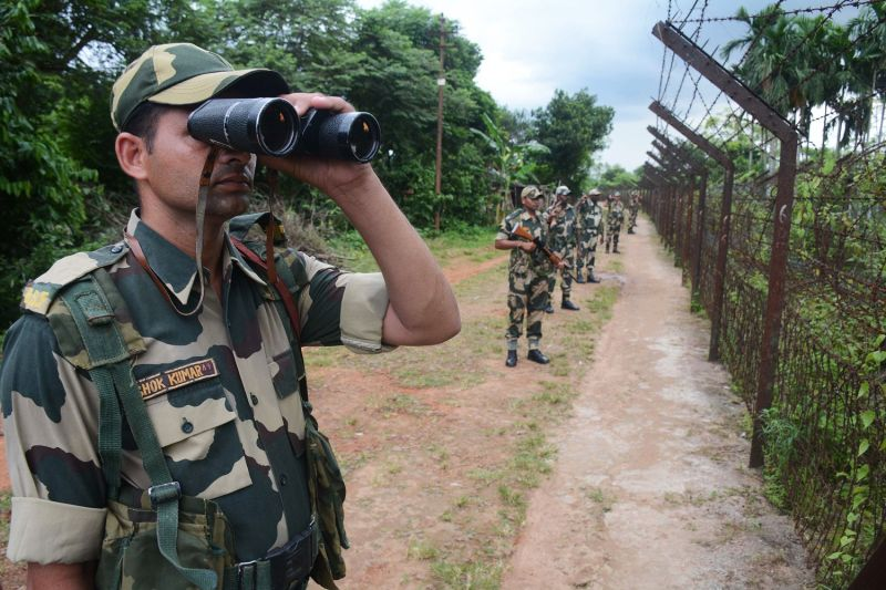 A Border Security Force (BSF) personnel patrols near the India Bangladesh fencing border ahead of 72nd Independence Day celebrations, at Lankamura village in Agartala, the capital of northeastern state of Tripura on August 13, 2018. (ARINDAM DEY/AFP/Getty Images)