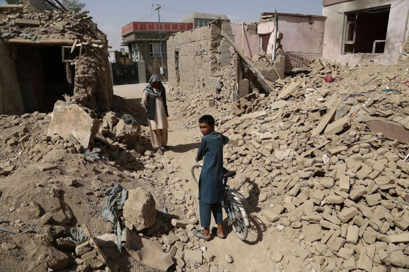 Afghan residents walk near destroyed houses after a Taliban attack in Ghazni on Aug. 16. (Zakeria Hashimi/AFP/Getty Images)