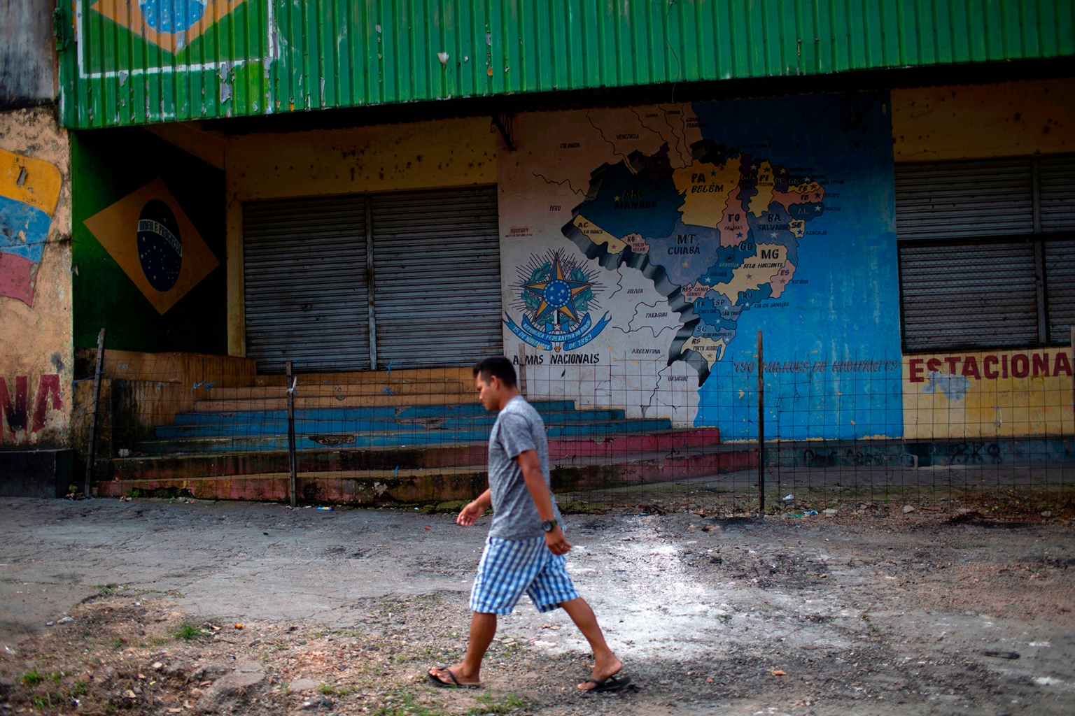 A man walks past one of the improvised refugee camps that was burned down last week by local residents in Pacaraima,  Brazil, on Aug. 20. MAURO PIMENTEL/AFP/Getty Images