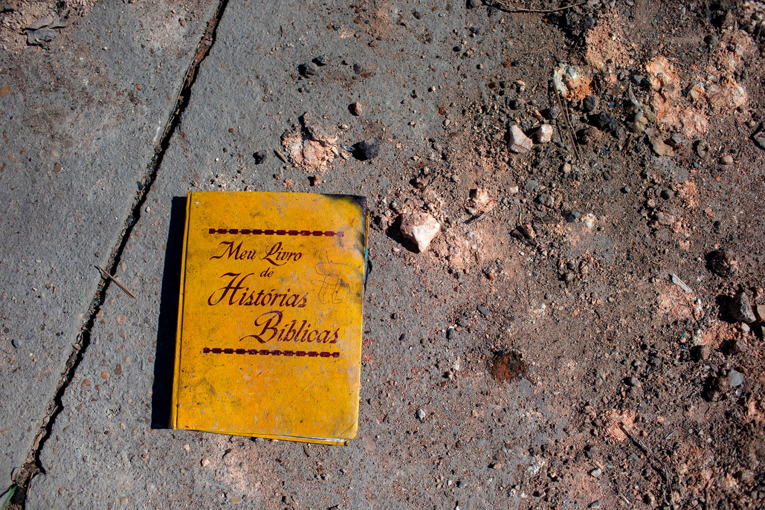 """A book titled """"My Book of Bible Stories"""" found in one of the burned camps where about 70 Venezuelans used to live in Pacaraima, Brazil, on Aug. 20. MAURO PIMENTEL/AFP/Getty Images"""