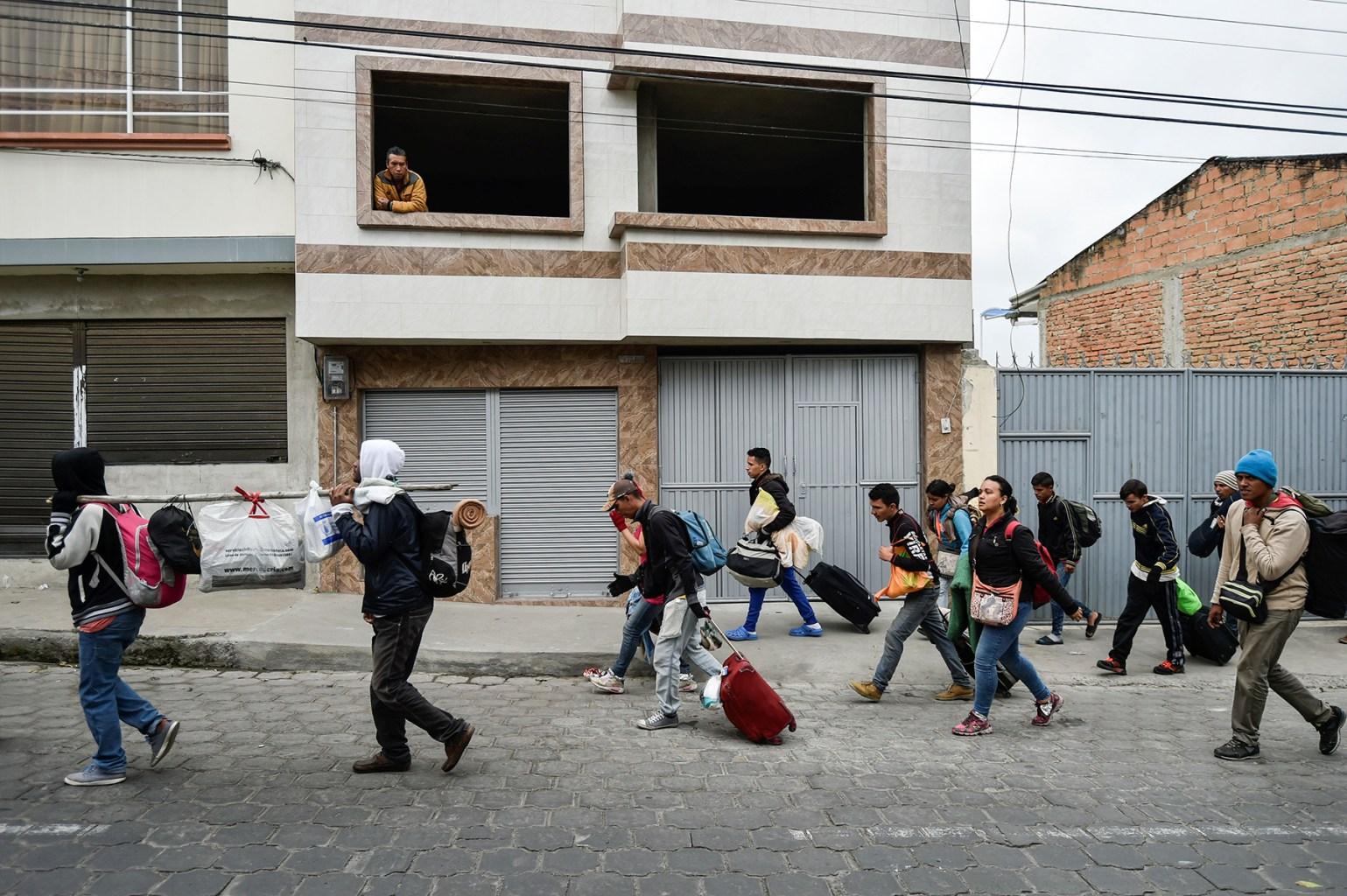 Venezuelan migrants heading to Peru walk along the streets of Tulcan, Ecuador, on Aug. 21. LUIS ROBAYO/AFP/Getty Images