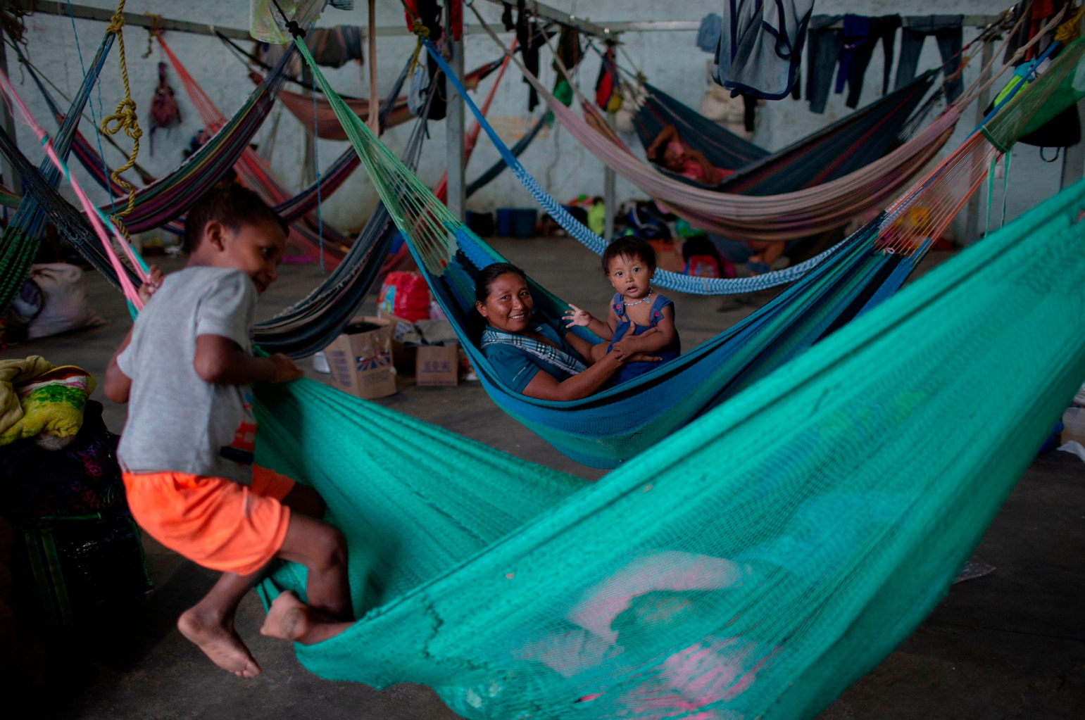 Members of the Warao tribe, Venezuela's second-largest indigenous group, rest at the Janokoida shelter in the border city of Pacaraima, Brazil, on Aug. 21. MAURO PIMENTEL/AFP/Getty Images